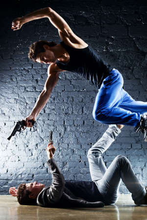 Men with guns fighting  Contrast colors  photo
