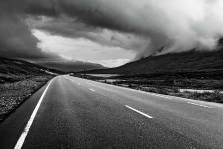 mountain road: Road perspective black and white colors  Norway  Stock Photo
