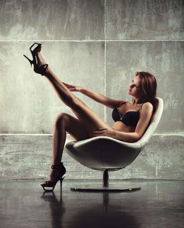 Young sexy woman on chair  photo