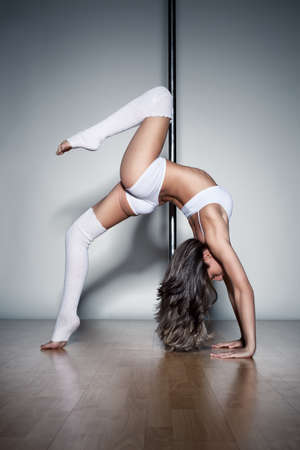 pole dancer: Young slim pole dance woman.
