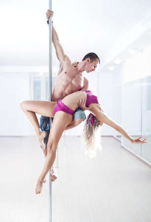 pole dance: Man and woman pole dance team.