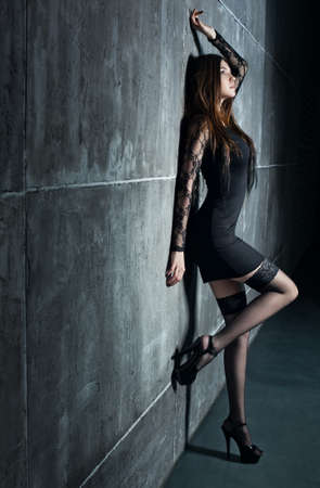 Young sexy woman standing at the wall. Stock Photo - 13555056