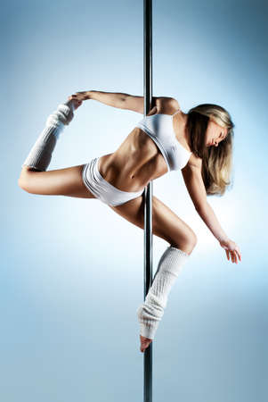 dance pose: Young slim pole dance woman