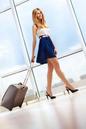 pulling beautiful: Young woman walking with travel bag  Stock Photo