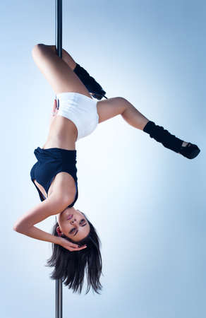 pole dance: Young slim pole dance woman