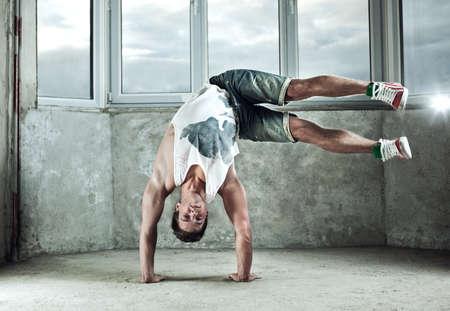 break down: Young strong man break dance.
