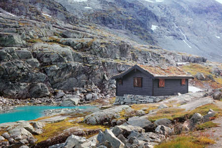 reclusion: House in high Norway mountains.