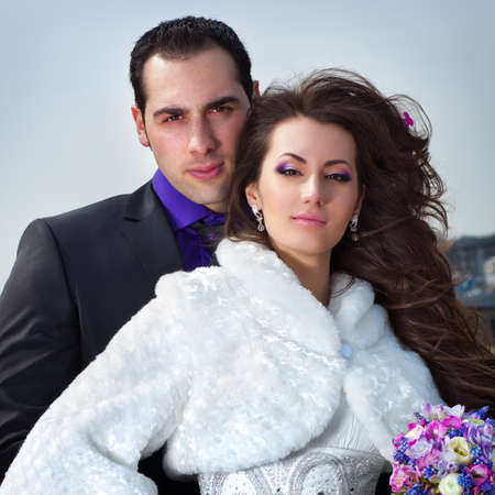 Young wedding couple portrait on sky background  photo