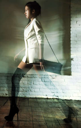 Young slim japanese woman fashion  Motion effect  photo