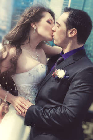 Young wedding couple kissing  Film style colors  photo