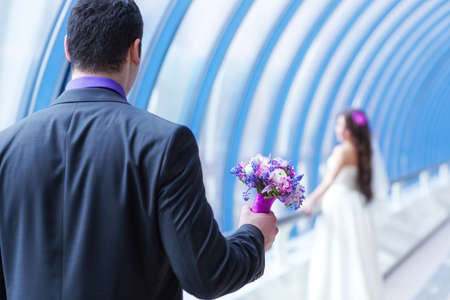 Young wedding couple. Focus on flowers. photo
