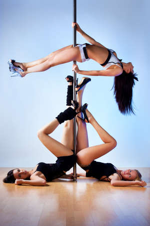 Three young slim pole dance women. Stock Photo - 15693479