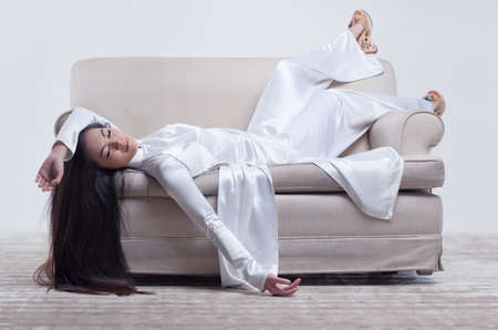 Young vietnamese woman resting on sofa  photo