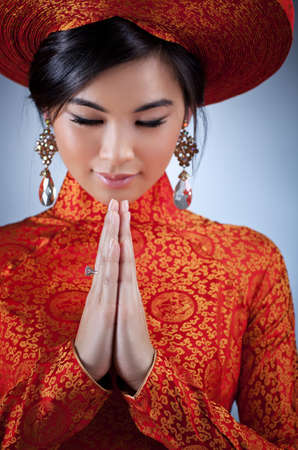 Young vietnamese woman in traditional clothing portrait  photo