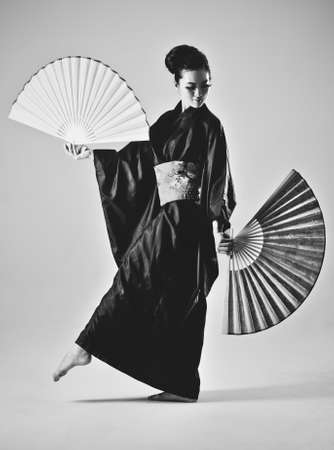 Young japanese woman with fans  Black and white film style colors