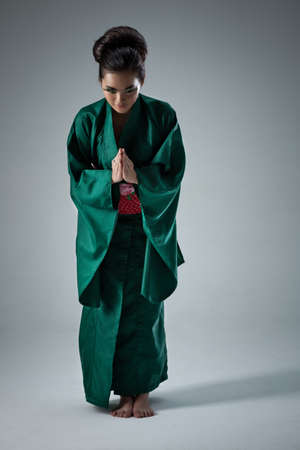 humility: Young japanese woman bow pose