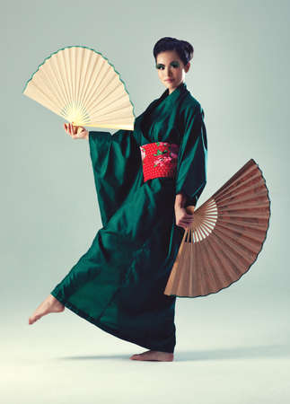 japanese kimono: Young japanese woman with fans