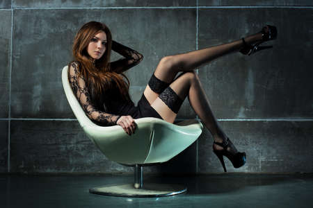 Young sexy woman on chair