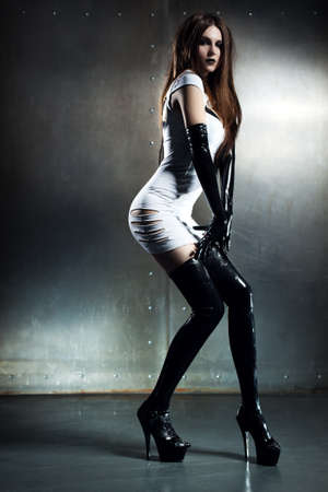 Young sexy goth woman on wall background Stok Fotoğraf - 16616582