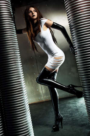 Young sexy goth woman on wall background