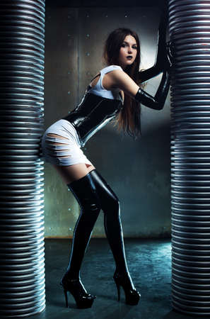 Young sexy goth woman on wall background Stok Fotoğraf - 16616613