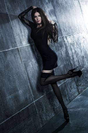 Young sexy woman standing at the wall  Stok Fotoğraf