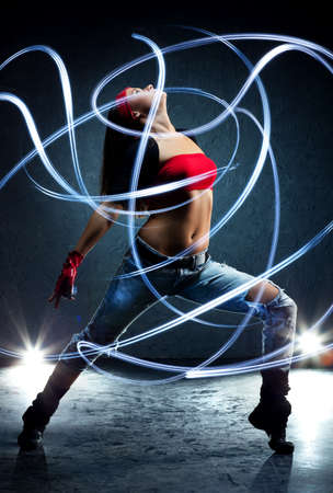 light traces: Young woman dancer with lights traces