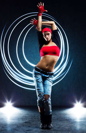 red jeans: Young woman dancer with lights traces