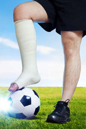 plaster foot: Football player with broken leg