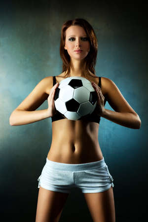 Young sexy woman football player  photo