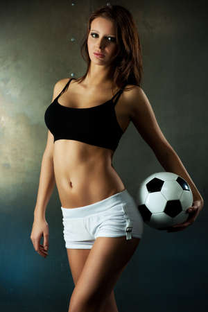 Young sexy woman football player. photo