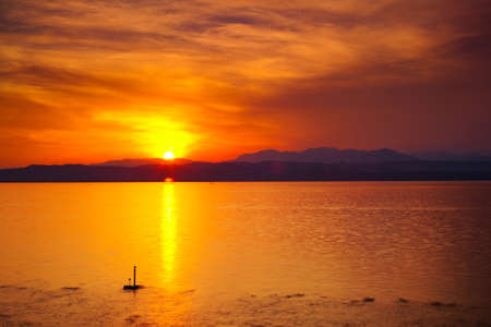 garda: Sunset over Garda lake in Italy  Stock Photo