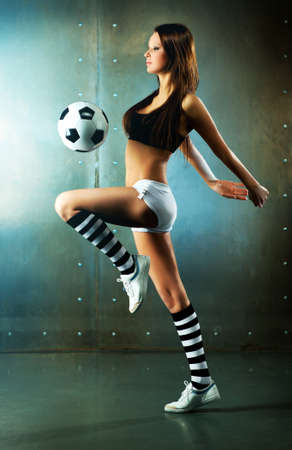 Young sexy woman football player