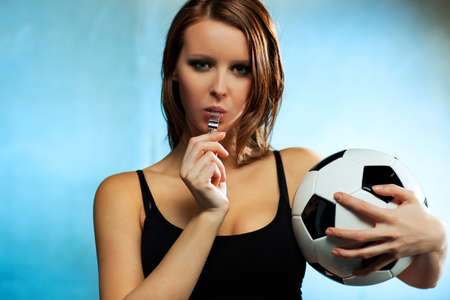 Young sexy woman football referee. photo