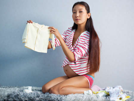 Young pregnant asian woman indoors  photo