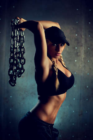 Young sports woman with heavy chain fashion portrait  photo