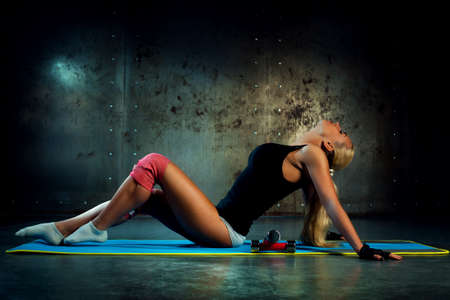 Young woman indoors fitness exercises