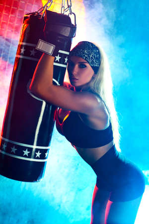 Young boxer woman portrait  Blue and red colors  Stock Photo - 18206750