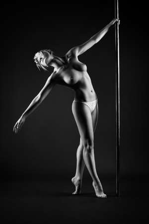 topless: Young slim pole dance topless woman