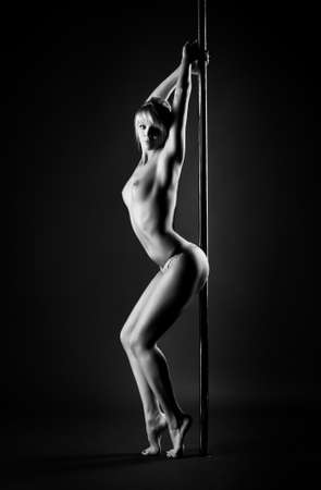 Young slim pole dance topless woman