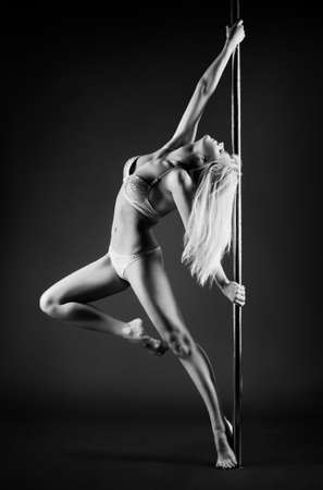 Young slim pole dance woman  photo