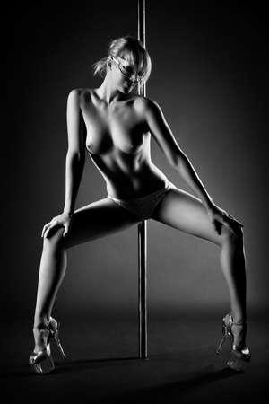 Young slim pole dance topless woman