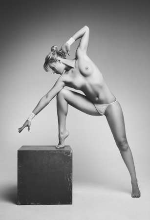 nude gymnast: Young nude woman  Black and white film style colors