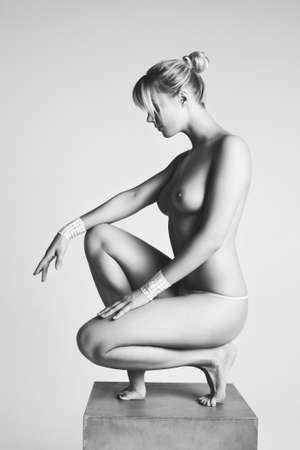 naked woman sitting: Young nude woman  Black and white