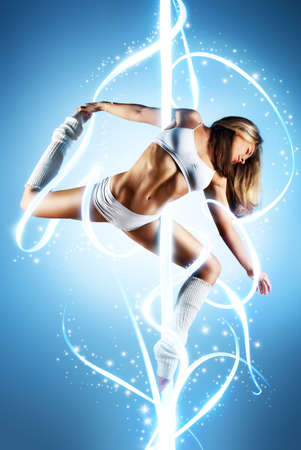 dancing pose: Young slim pole dance woman with lights.
