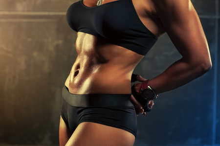 nude abs: Young sports woman abdominal muscles.