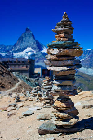 Big hand-made stone tower in Alps  photo