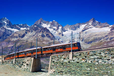 Train in high Alps mountains  photo