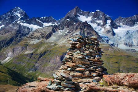 Big hand-made stone tower in Alps. photo
