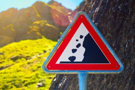 rockfall: Road sign. Danger falling stones. Stock Photo